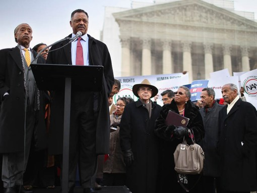 WASHINGTON, DC - FEBRUARY 27:  Rev. Jesse Jackson and Rev. Al Sharpton (L) deliver remarks during a rally on the steps of the U.S. Supreme Court February 27, 2013 in Washington, DC. Leaders from Congress joined civil rights icons to rally as the court prepared to hear oral arguments in Shelby County v. Holder, a legal challenge to Section 5 of the Voting Rights Act. (Photo by Chip Somodevilla/Getty Images)